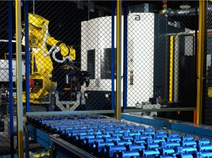 A typical Robot System integrated with a Machining Center…complete with safety fencing, monitoring and part queuing stations