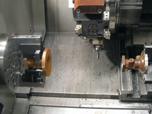 Typical set-up with sub-spindle and live tooling to completely machine part in one process.