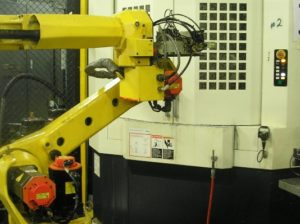 One of two Horizontal Machining Centers with a single robot for load/unload of parts.
